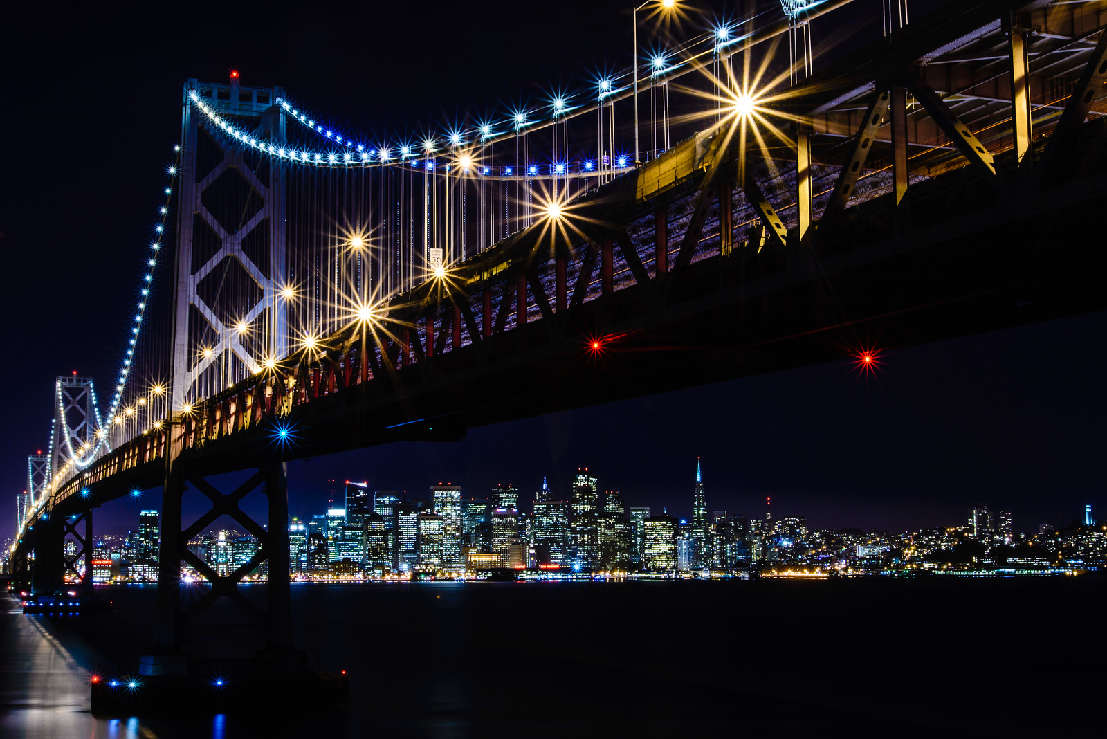 Met a few new great photographers shooting the Bay Bridge last night at sunset, so we decided to try to find our way down below the bridge.  Success!  First published shot with the new d600, and I don't know about you all, but I can really tell the difference.  So happy with my purchase so far.